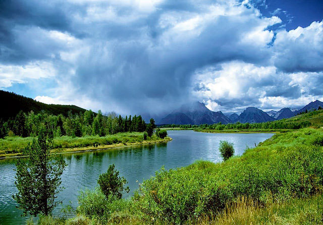 Snake River along             with the Grand Tetons in Wyoming --